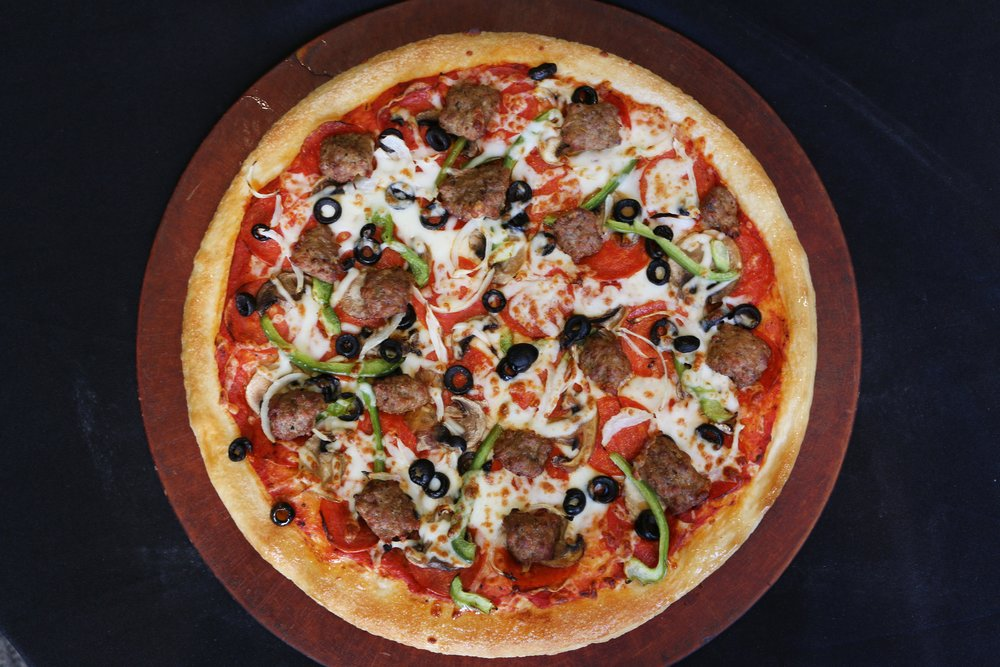 Deep Dish Deluxe Pizza-  Starts with our fresh daily prepared pizza dough, then topped with pepperoni, sausage, mushrooms, onions, bell peppers, & black olives.