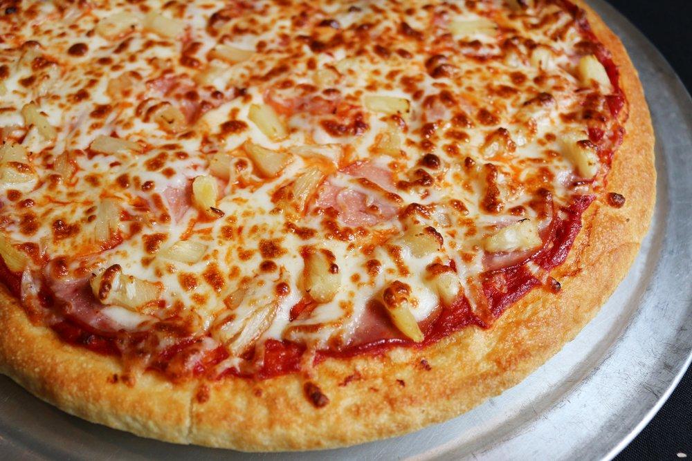 Deep Dish Hawaiian pizza topped with pineapple and ham.