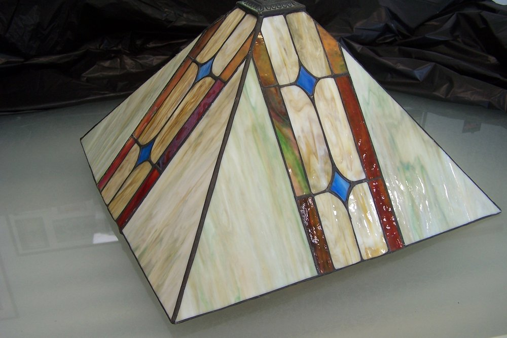 The cap had pulled away from this stained glass lampshade, but the Shoppe was able to give it a makeover!