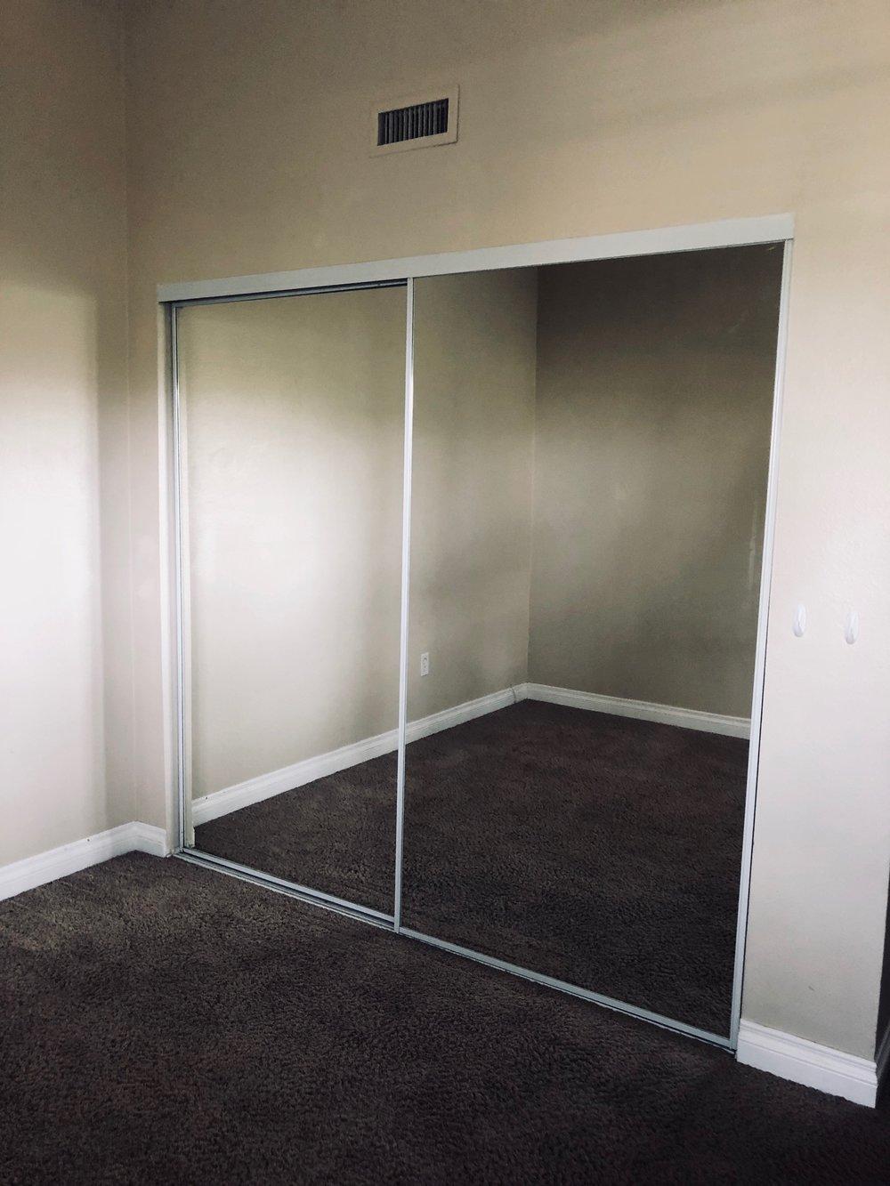 Double Track Mirrored Closet Door