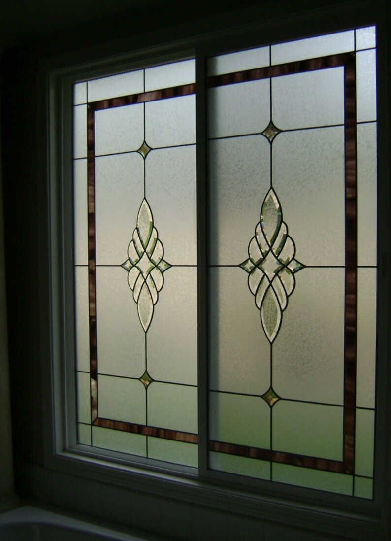 Lead and Bevel Sliding Window