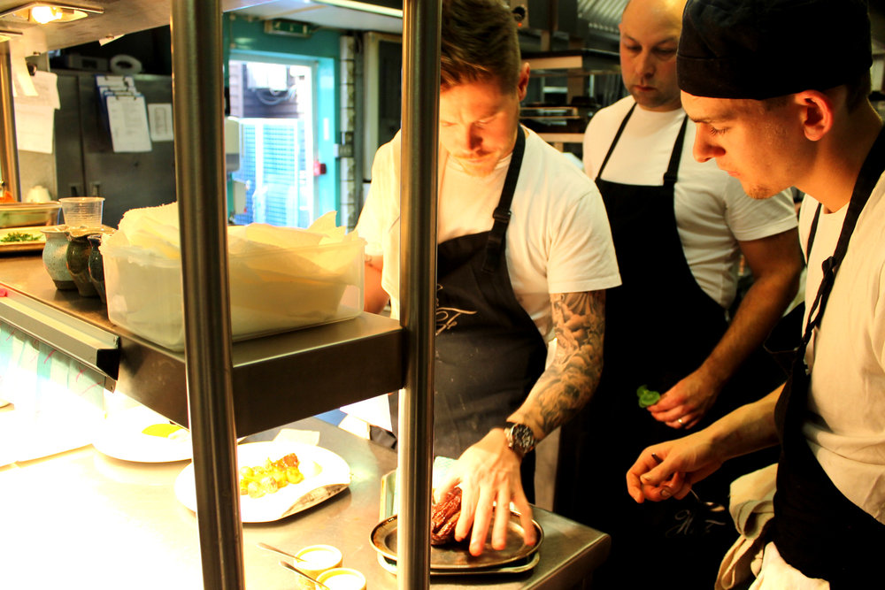 Aaron Mullins, the head chef, at the pass