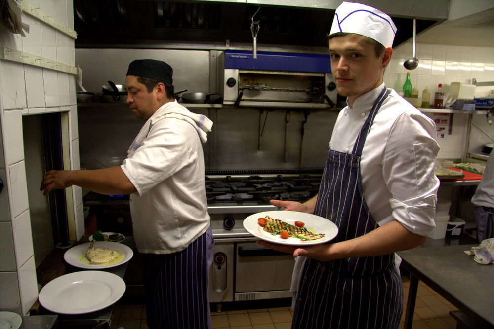 the stagiaire with a dish