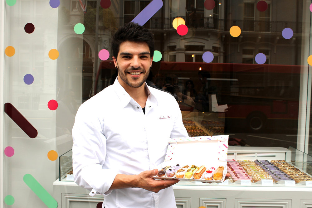 Joakim Prat and a box of his fresh éclairs