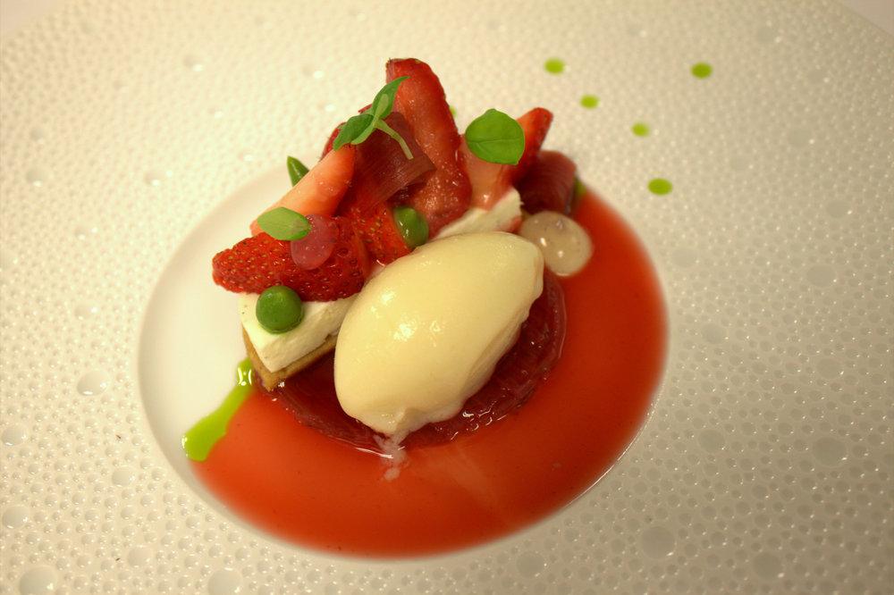 Gariguette strawberries, rhubarb, biscuit, Tonja bean cream, basil purée, salt and lemon sorbet.