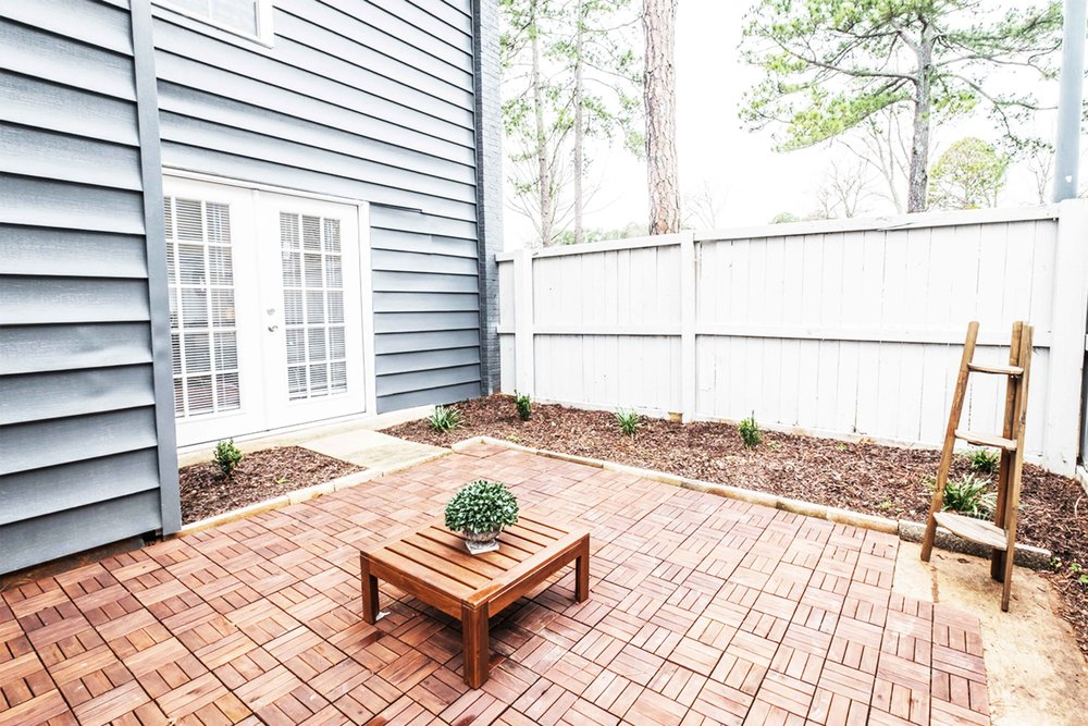 Fenced In Patio - The FoundryEach town home comes with an over-sized fenced in patio that a designated concrete area for patio furniture and grilling! Enjoy privacy while enjoying beautiful weather and surrounded by nature.