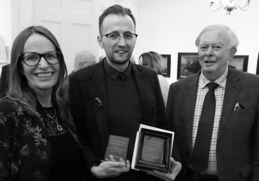 Iain MacDonald (centre) with his two awards, with Charles Scott, Chair of the Scottish Arts Club Charitable Trust and Sara Cameron McBean, Scottish Arts Club Short Story Director.