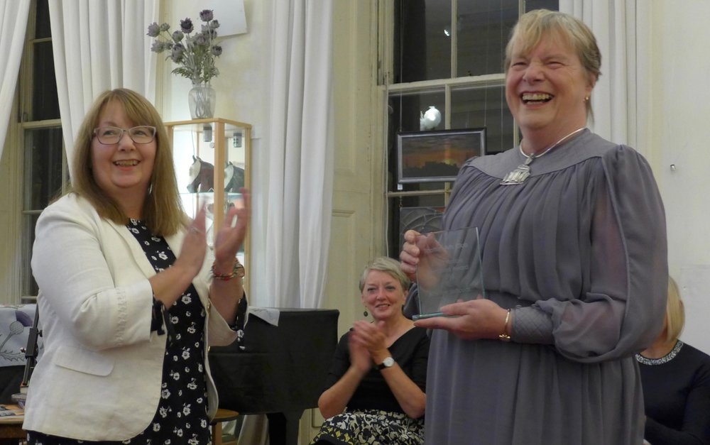 Marilyn Jeffcoat gets her surprise Flash Fiction Member's Award
