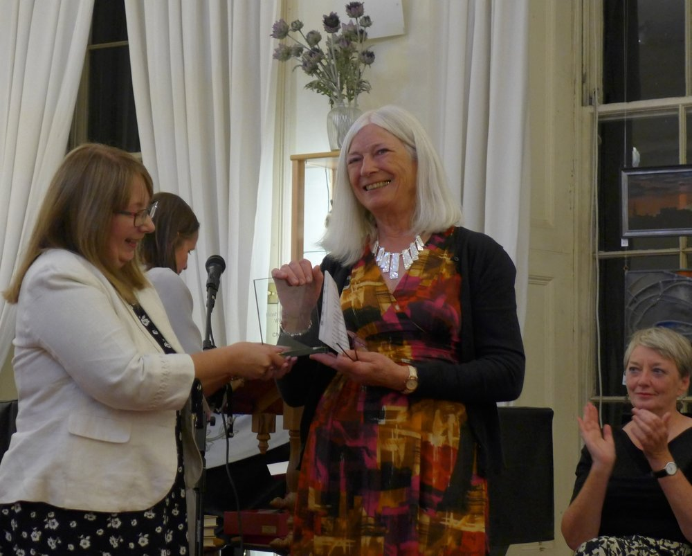 Christina Eagles receiving the inaugural Edinburgh International Flash Fiction Award 2018 from chief judge Sandra Ireland.