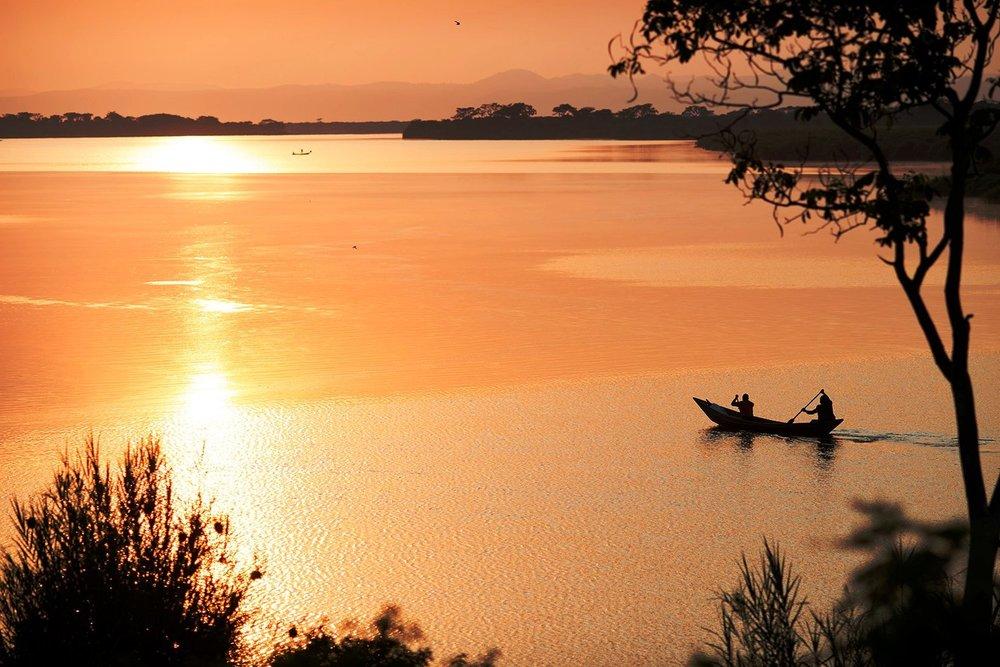 Copy of Golden+sunset+canoe++Mutanda+Lake+Resort+_+Uganda.jpg