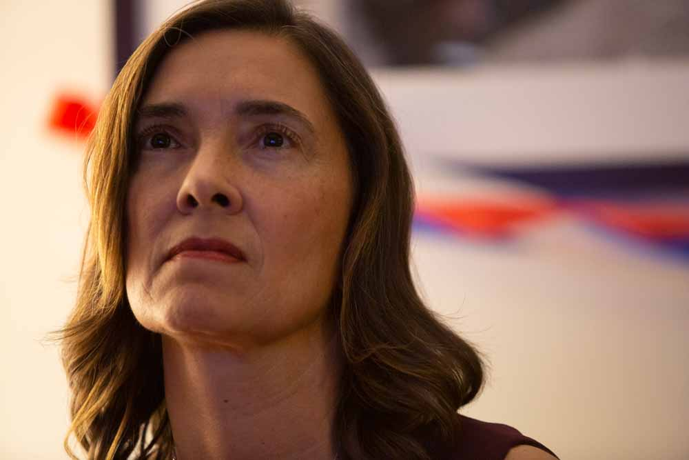 Anita Earls nervously watches the results from other state races come in on the television on election night, waiting for her own race to be called.