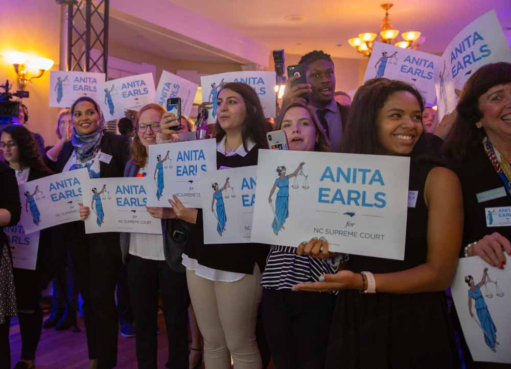 At the North Carolina Democratic Party headquarters in Raleigh, Earls is met with a vivacious crowd of supporters after her victory is announced as the 100th justice of the North Carolina Supreme Court.
