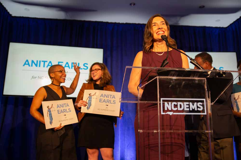 "Anita Earls takes the stage at the North Carolina Democratic Party headquarters as her supporters cheer below. Juju Holton and Caroline Spencer, who both worked on the campaign, shed tears and celebrate behind her.  ""We have a president who believes that he can by executive order erase the 14th amendment to the U.S. constitution,"" Earls says in her speech. ""We have misguided misguided partisans in our state who believe they should impeach justices that don't rule in their favor. I promise to resist partisan attacks on the judicial branch, which must remain independent and impartial in order for our democracy to succeed and thrive. Thank you for believing in the possibility that a civil rights attorney can run a state-wide campaign and win the trust of voters. Thank you for believing that you can make a difference because you have. And now, let's move forward without fear or favor."""