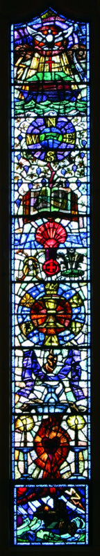 The third window on the left represents the church in action, and illustrates the instruments used in worship (from the bottom up): the ewer and basin for service; the purple stole representing penance; the chalice and paten used in Holy Eucharist; the marriage knot; the Prince of Wales feathers symbolising the Holy Spirit; the baptism shell; and the Bible (middle). Above is the ark, the symbol of the church, with the cross on top, and the inspiration of the Holy Spirit represented by the dove.