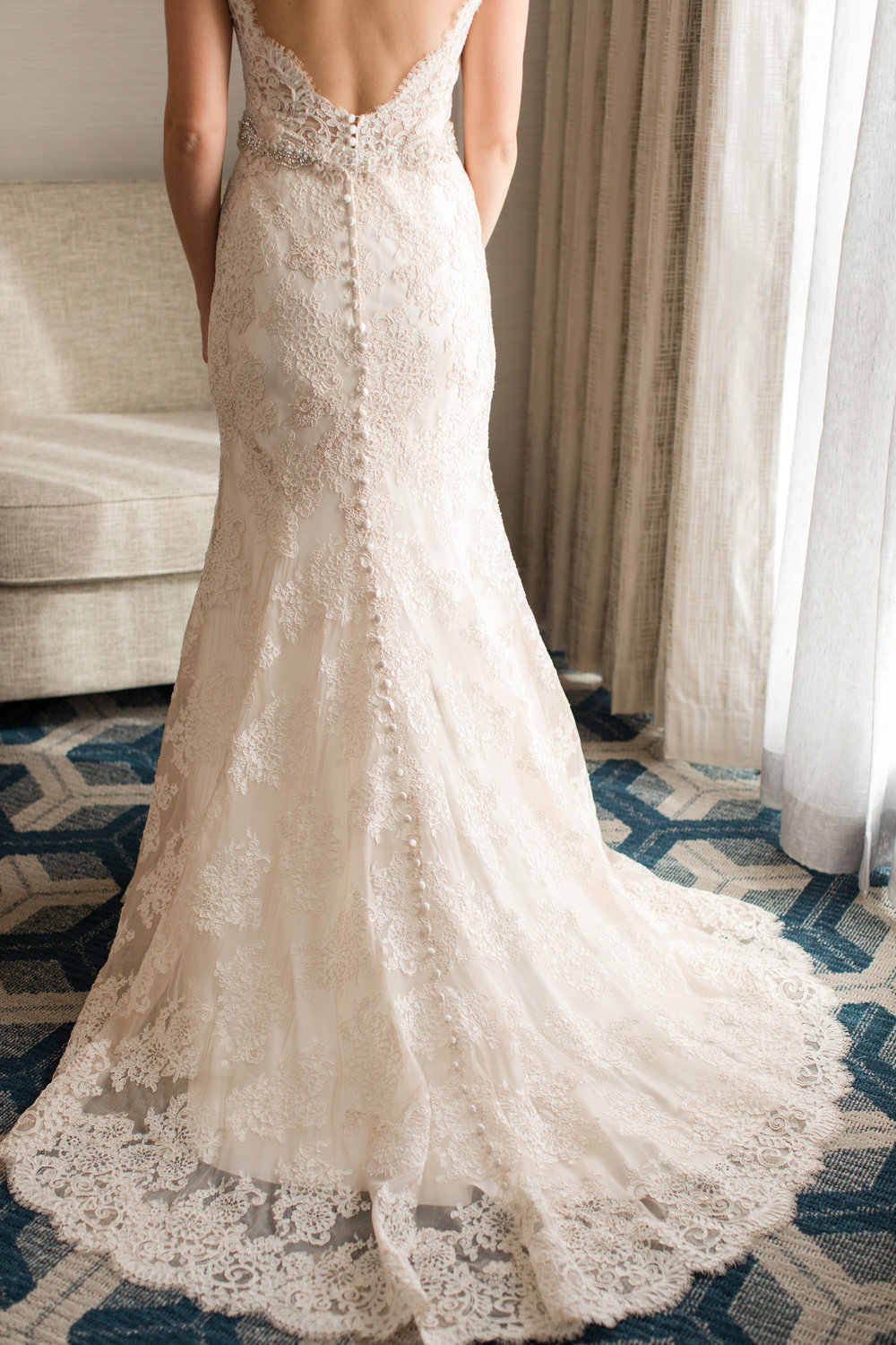 allure bridal lace wedding dress with low back and buttons at sheraton eatontown