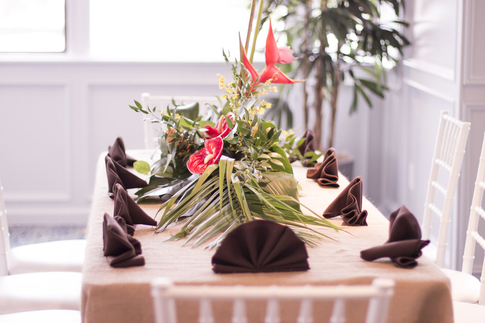 tropical centerpiece on long table for amazon jungle themed mitzvah