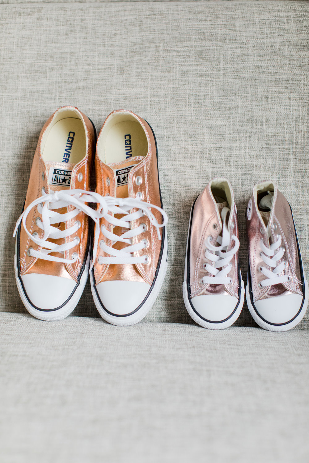 Bride and flower girl rose gold converse wedding shoes.