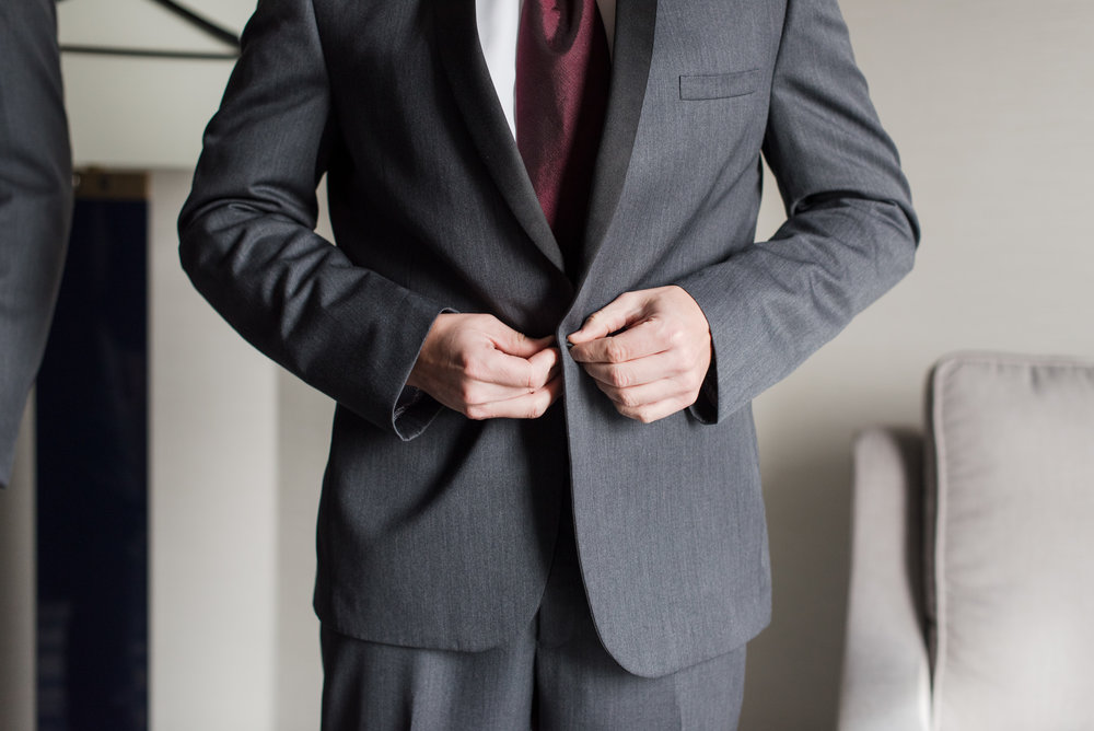 room putting on black and gray forum tuxedo jacket