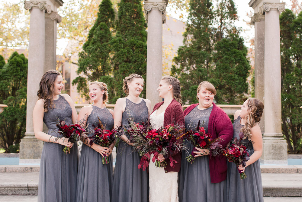 Bridesmaids in gray chiffon wedding dress with dark red bouquets