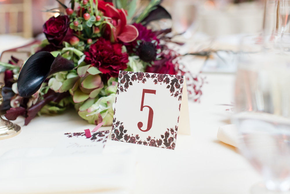 library inspired fall wedding table numbers and flowers