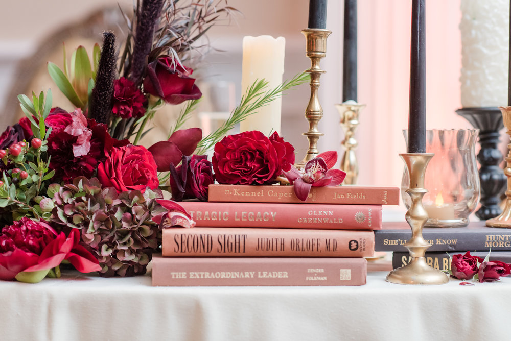 library inspired wedding centerpieces with vintage books fall flowers and candles