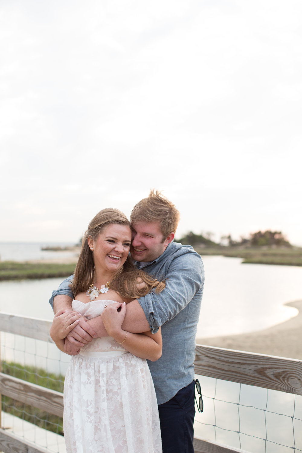 beach engagement photo shoot with jaye kogut photography on boardwalk