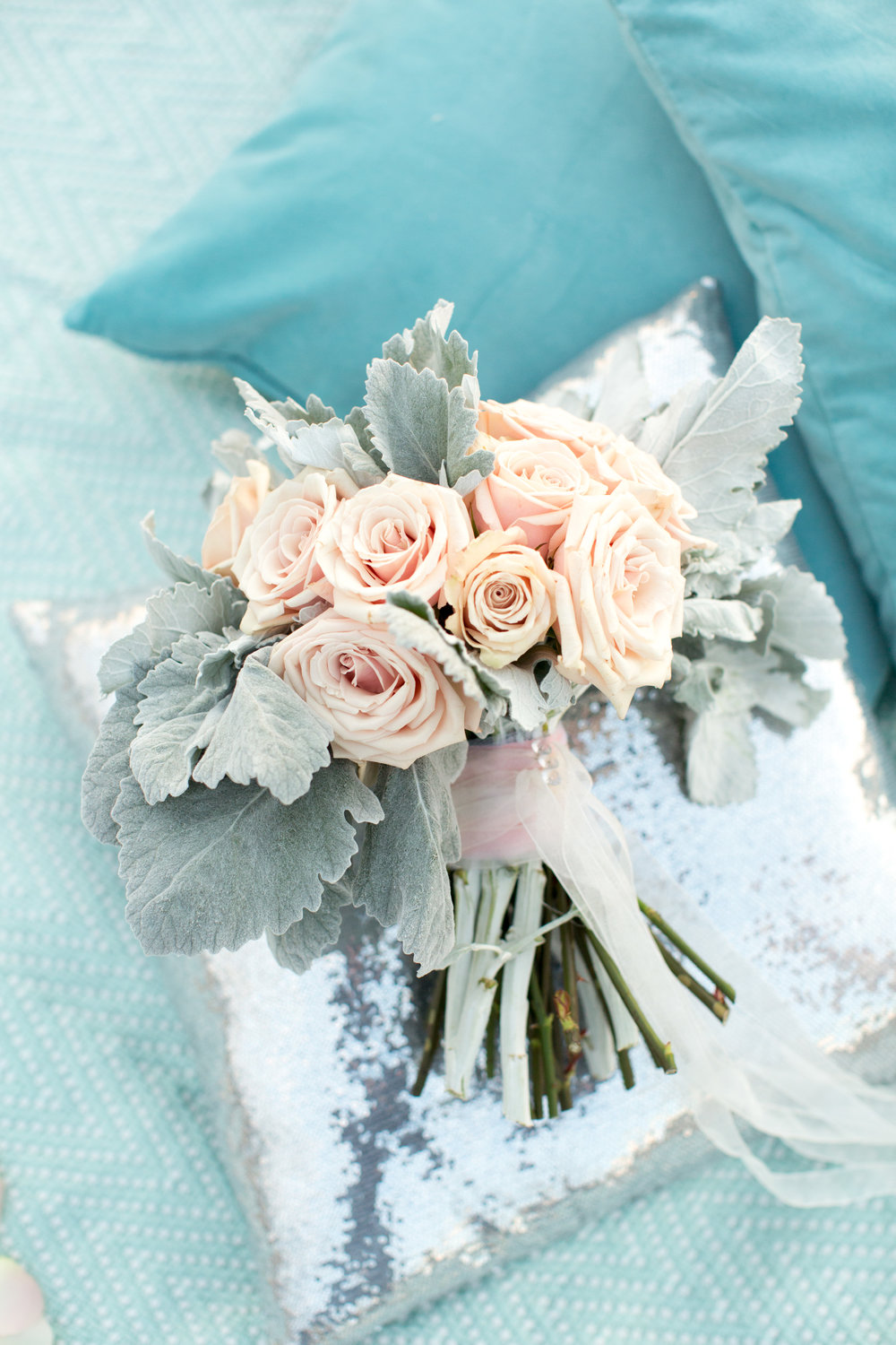 blush pink rose and dusty miller bouquet with sheer ribbon and pearl detail for beach wedding or engagement