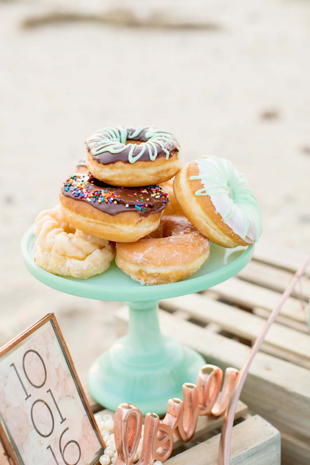 beach engagement photo shoot props and donuts