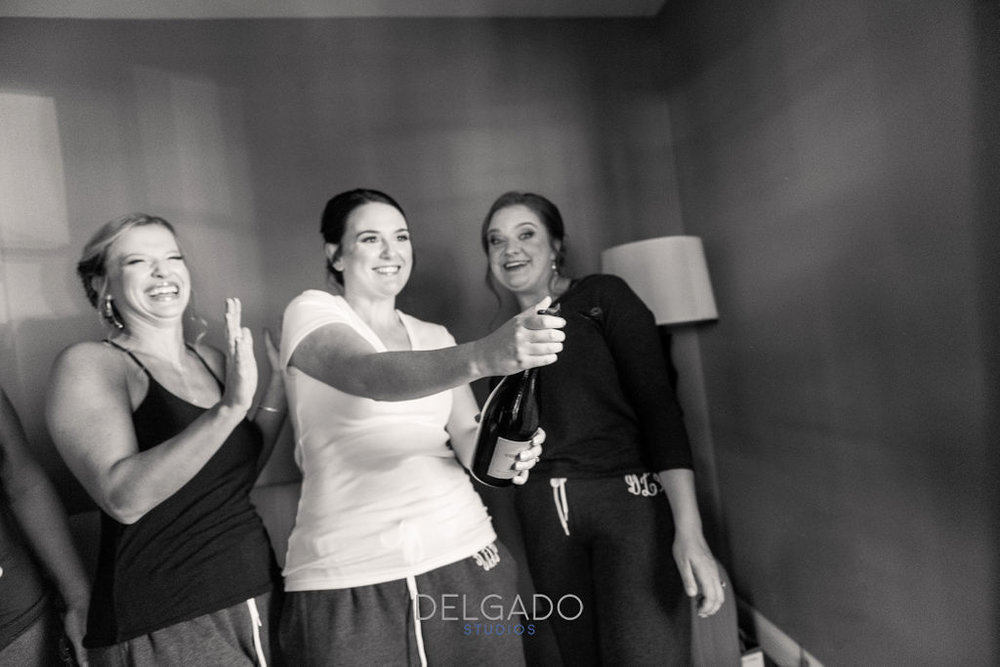 modern traditional nj hotel wedding bridesmaid champagne pop