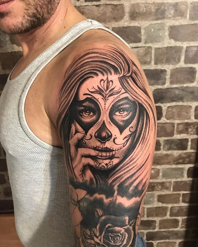 Sugar skull tattoo. #tattoo #freshink #newtattoo #torontotattooartists #torontotattoos #tattooartisttoronto #sugarskull #dayofthedead #skulltattoo