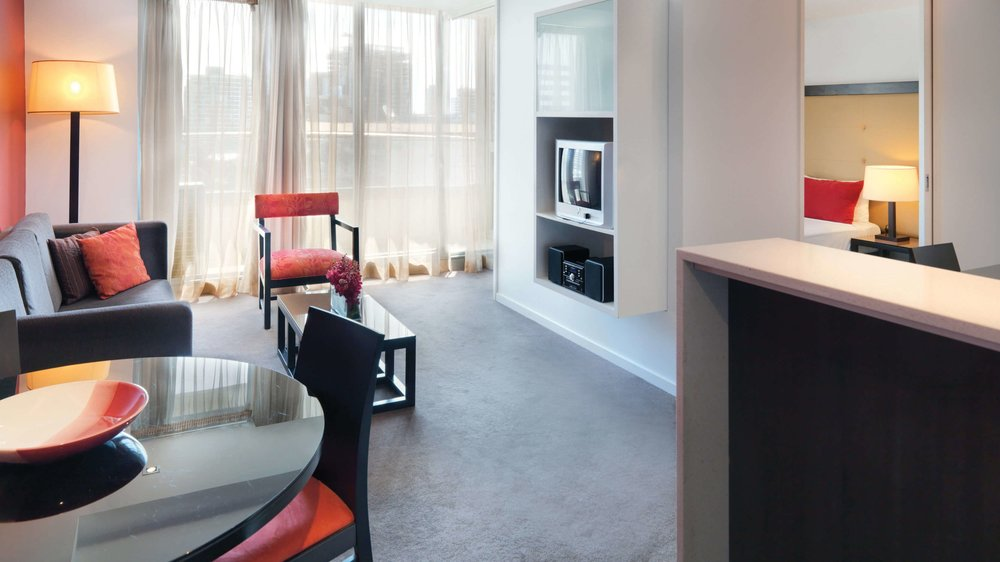 adina-apartment-hotel-melbourne-northbank-one-bedroom-apartment-lounge-room-2012.jpg