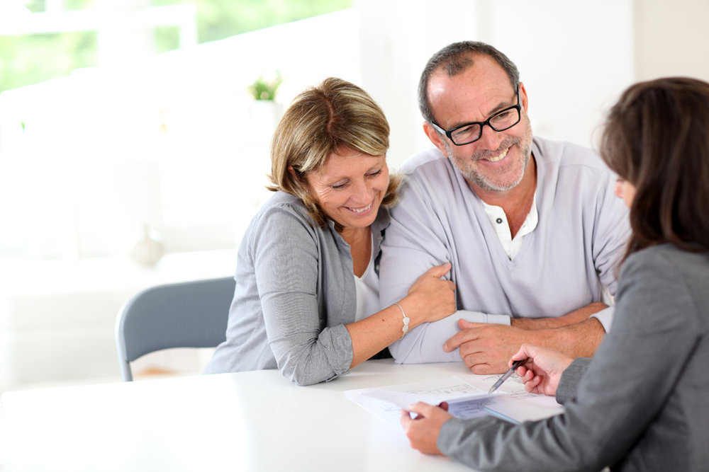 bigstock-Senior-couple-signing-financia-33875234.jpg