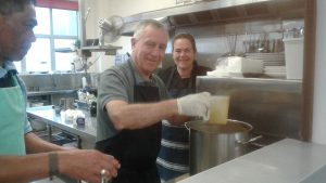 Cardinal John helped serve breakfast at the Soup Kitchen.