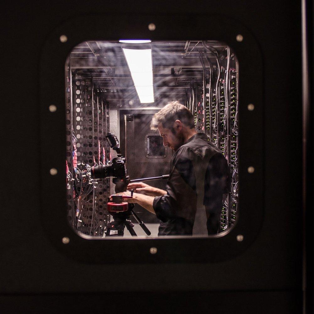 Male filming on a train.jpg
