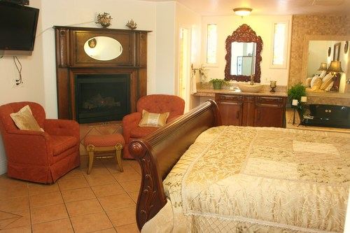 KING BED  Features: Antique furnishings, fireplace, stained glass, Jacuzzi tub, patio.