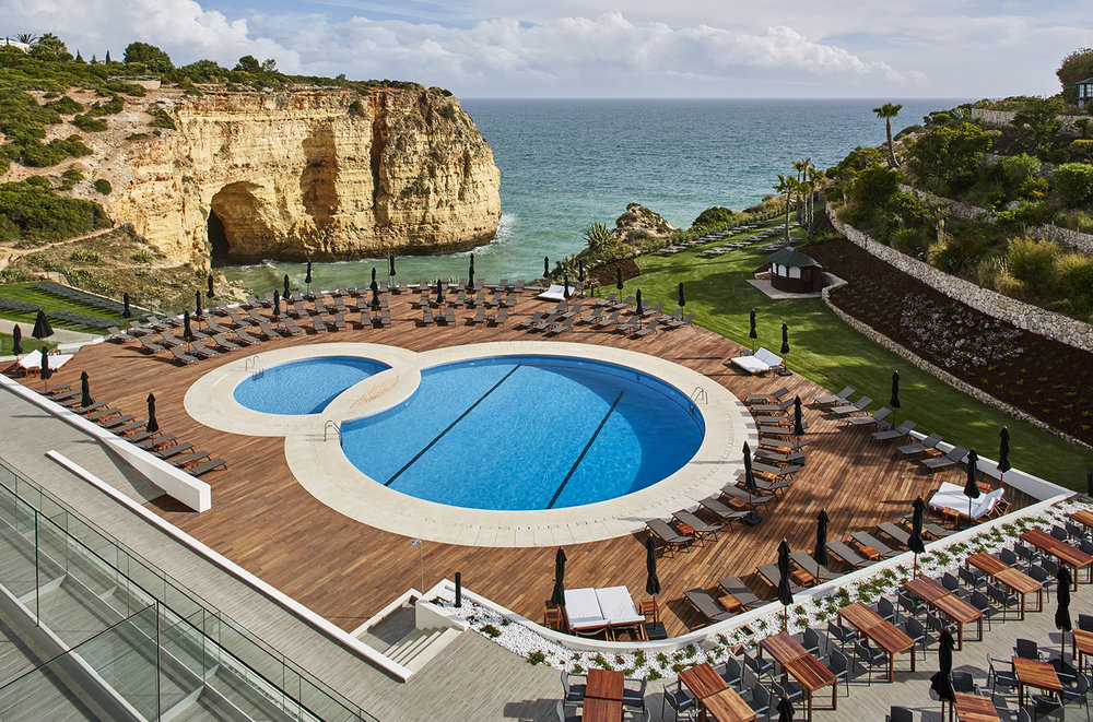 Enjoy a light meal from Mare Bistro by the pool at the Tivoli Carvoeiro Algarve Resort.