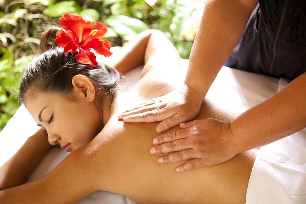 A guest gets a massage in the garden cabana.