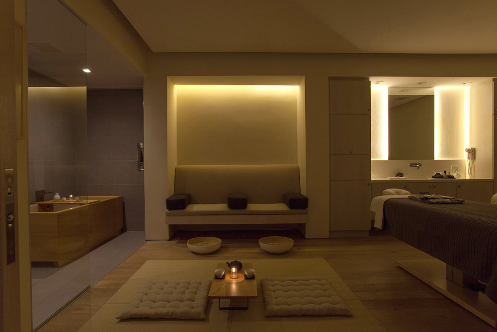 Couples receive treatments together in a relaxing private suite.