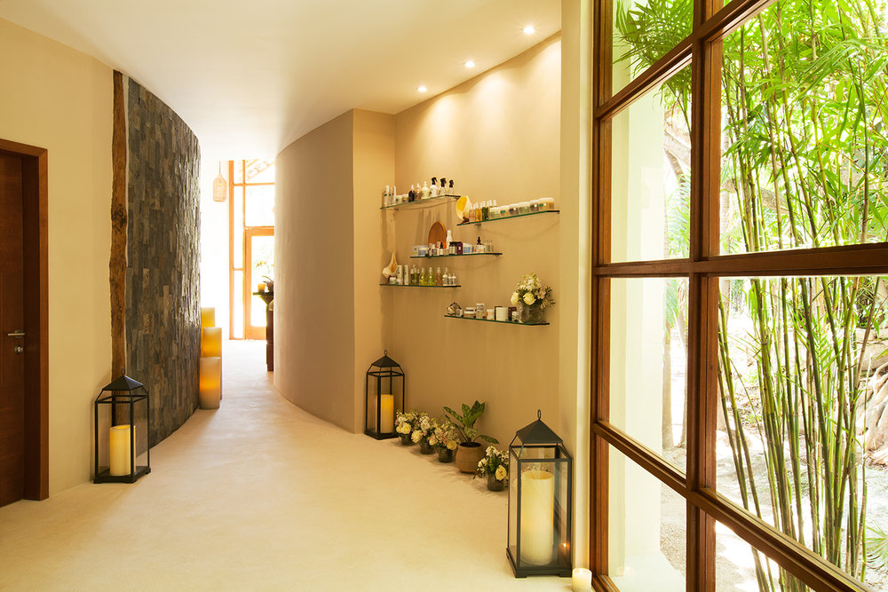 The spa features antique wood furniture, subtle lighting and louvered windows.