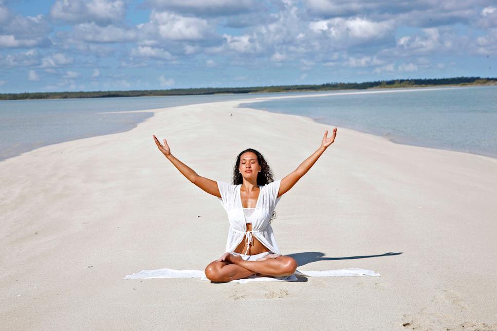 Beach Yoga at Kamalame Cay.