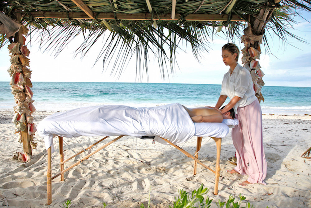 A relaxing seaside massage at Kamalame Cay Resort.