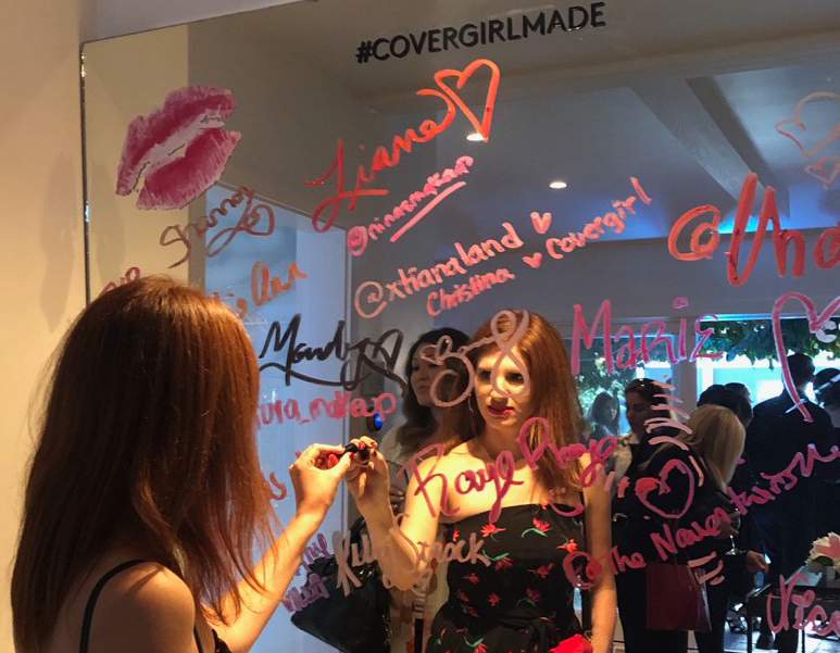 Signing my name to the Covergirl lipstick mirror!