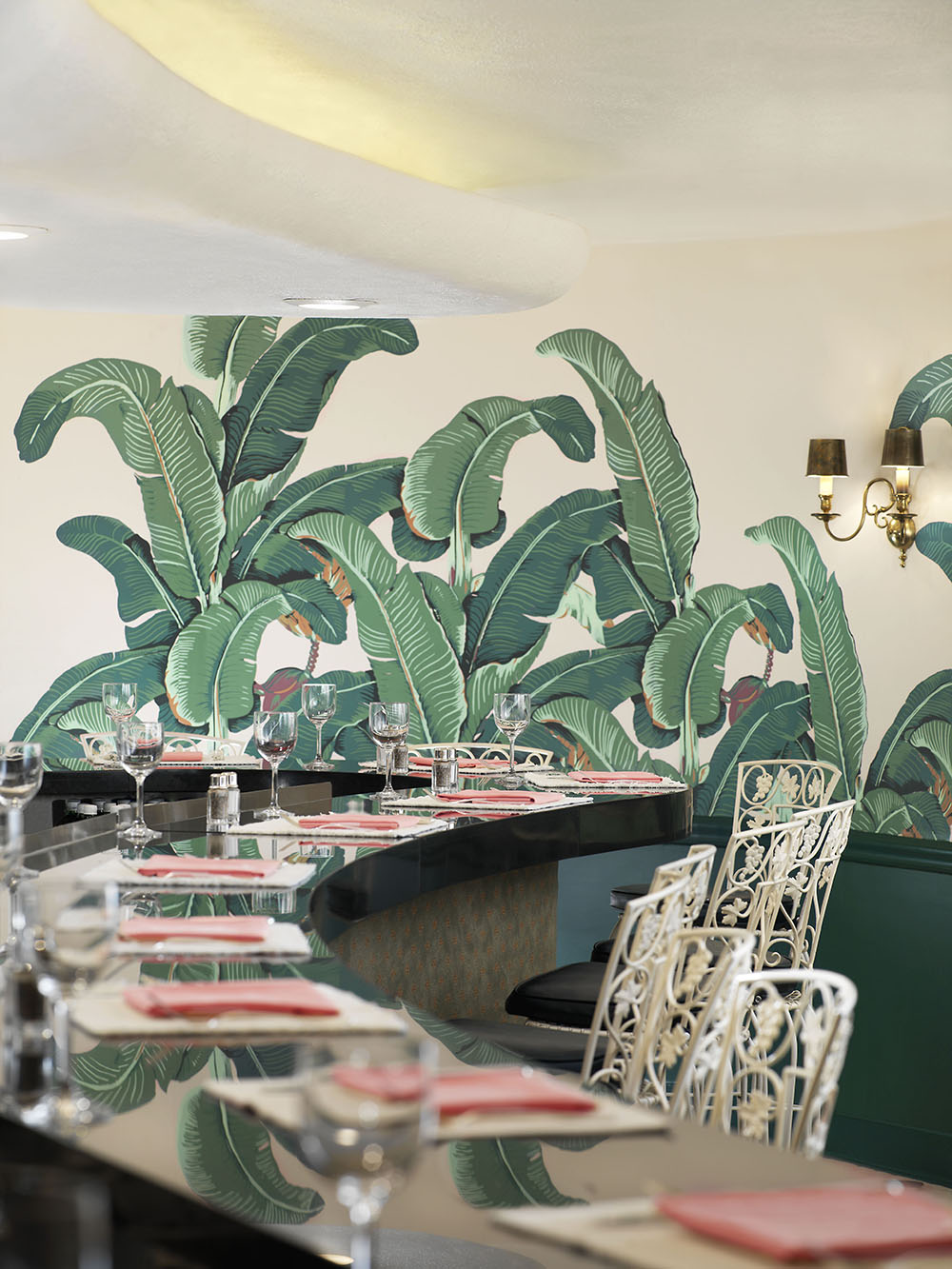 The signature banana leaf wallpaper in the hotel's Fountain Coffee Room.