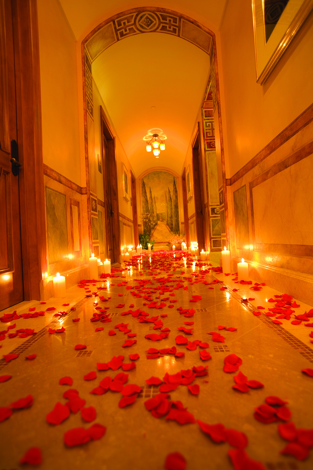 The candlelit hallway leads guests on their spa journey.