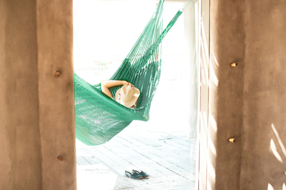 Lounge in one of the many hammocks located throughout the grounds.