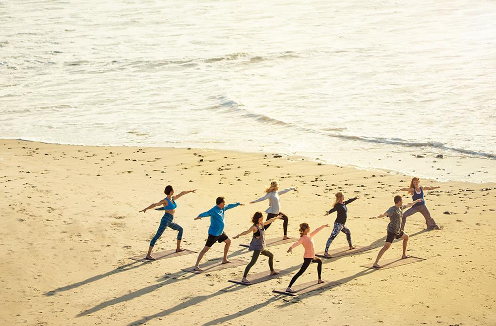 Group-Beach-Yoga_Miraval_MB.jpg