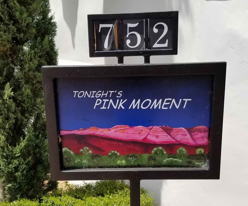A sign at the Ojai Valley Inn and Spa shares the daily time for the Pink Moment.