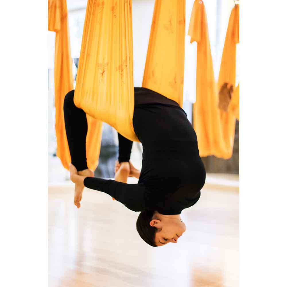 Anti-gravity yoga is one of the activities offered at the Wellnessing Getaway.