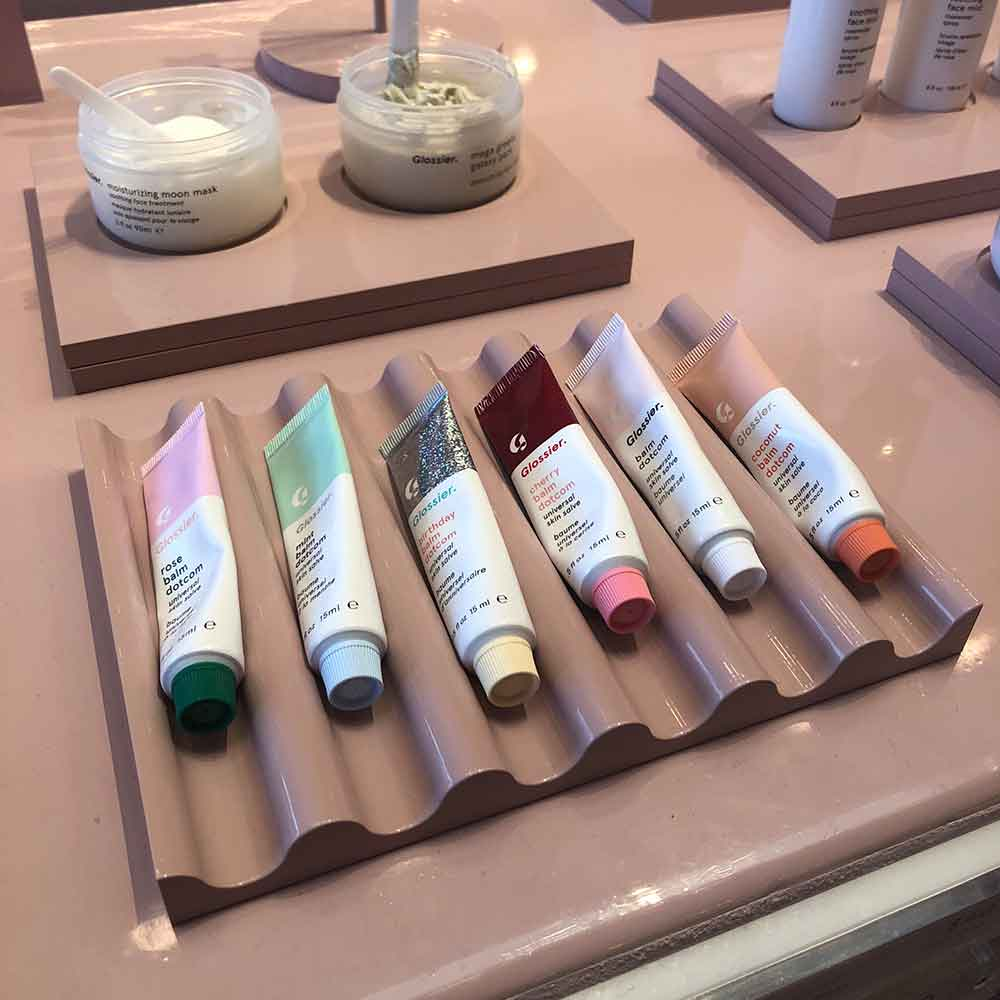 An assortment of Balm Dotcoms at the Glossier store in Los Angeles.