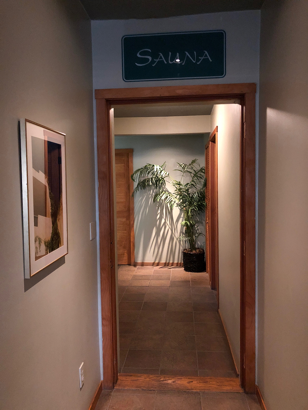 The hallway leading to the dry sauna and treatment rooms.